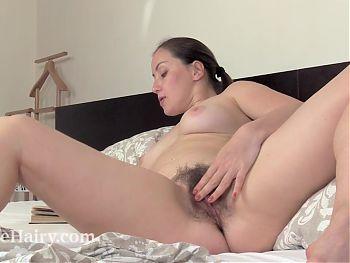 Liana reads in bed and masturbates